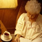 Senior reading with a cup of tea